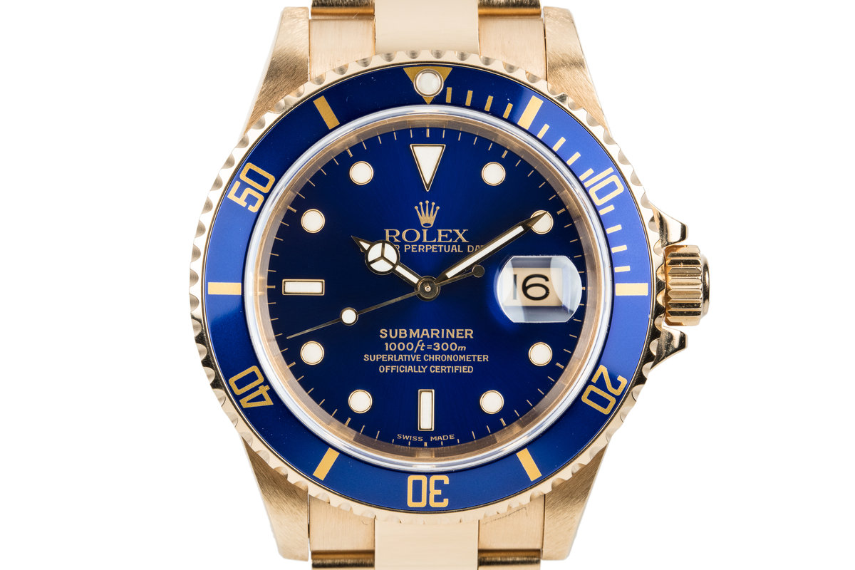 1999 Rolex 18K YG Submariner Blue Dial with Box and Papers photo, #0