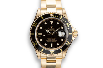 2003 Rolex 18K YG Submariner 16618 T Black Dial with Box, Papers, and Service Papers photo