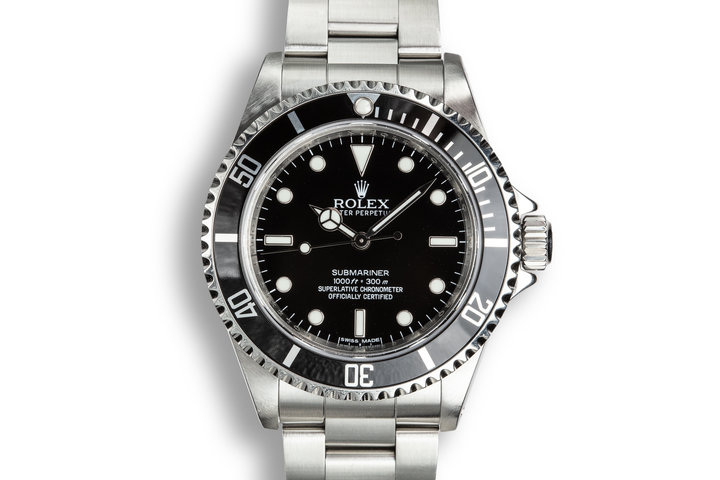 2010 Rolex Submariner 14060 with 4-Line Dial and Box and Papers photo