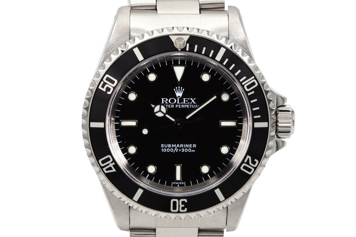 1999 Rolex Submariner 14060 with Uncommon Swiss Dial photo