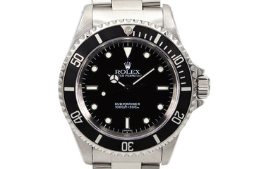 1999 Rolex Submariner 14060 with Uncommon Swiss Only Dial photo