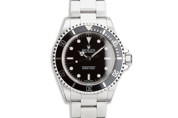 Unpolished 2002 Rolex Submariner 14060M with Box and Papers photo