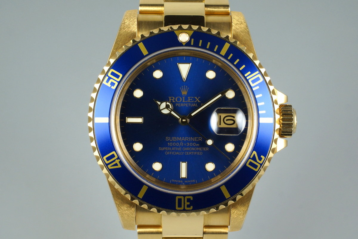 1985 Rolex YG Blue Submariner 16808 with Box and Papers photo, #0