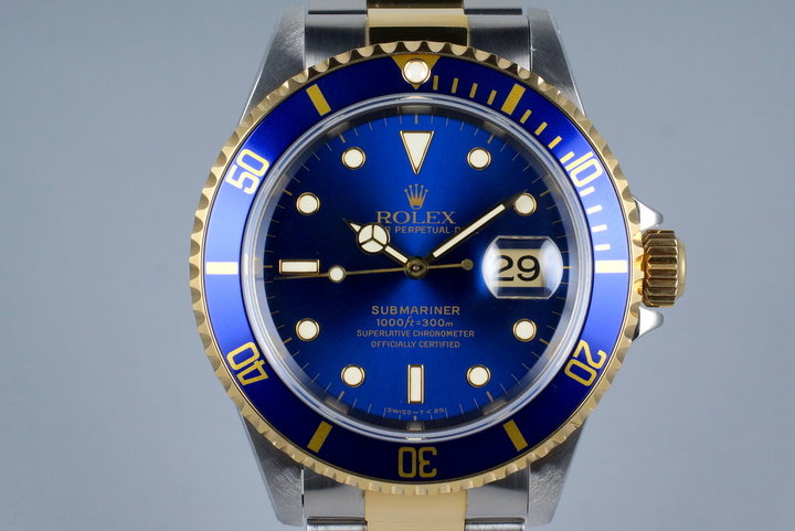 1995 Rolex Two Tone Blue Submariner 16613 with Box and Papers photo