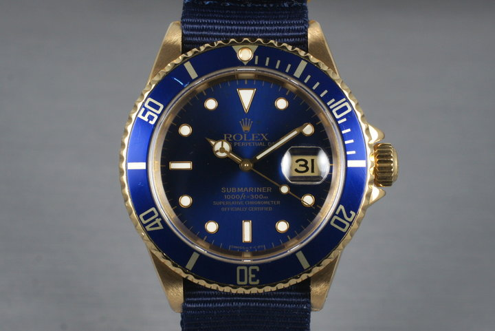 1991 Rolex 18K Blue Submariner 16618 with Box and Papers photo