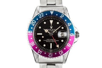 1960 Rolex GMT-Master 1675 with Pointed Crown Guard Case, Gilt Exclamation Dial, and Fuchsia Bezel Insert photo