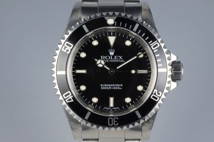 2002 Rolex Submariner 14060M with Box and Papers photo