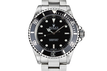 2000 Rolex Submariner 14060 with Rolex Service Papers photo