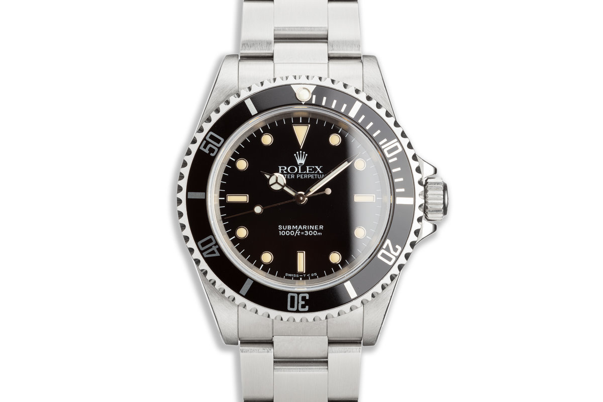 1990 Rolex Submariner 14060 with Box and Papers photo, #0