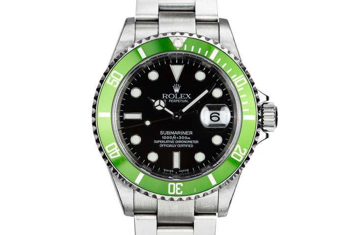 2003 Rolex Anniversary Green Submariner 16610LV Mark I Dial with Flat 4 Bezel photo