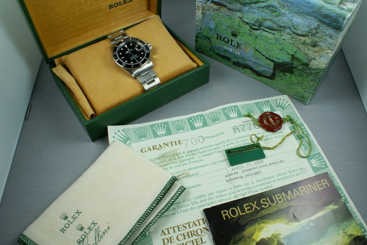 Rolex Submariner 16610 Box and Papers A serial photo