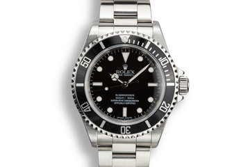 2006 Rolex Four Line Submariner 14060M with Box and Papers photo