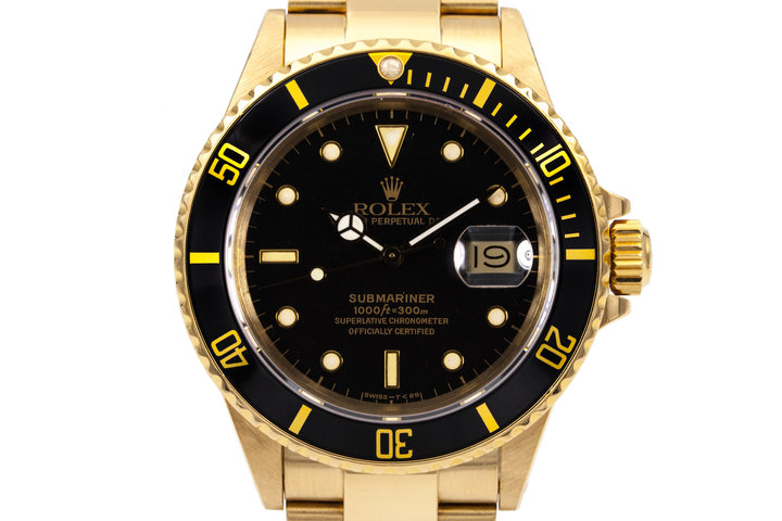 1988 Rolex YG Submariner 16808 Black YG Surround Dial with Box and Papers photo