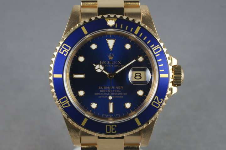 1993 Rolex 18K Submariner 16618 with Box and Papers photo