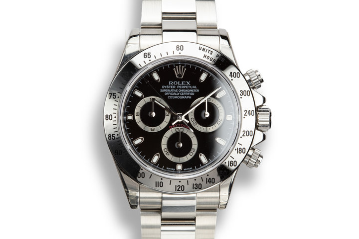 2003 Rolex Daytona 116520 Black Dial Still In Factory Protective Stickers with Box and Papers photo