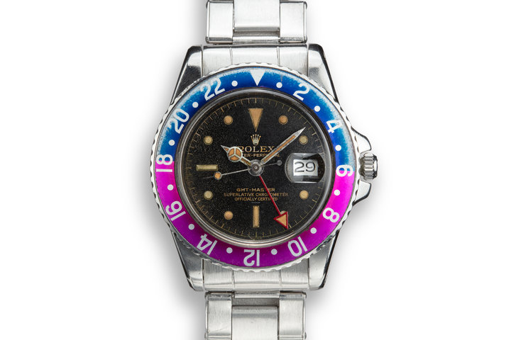 1963 Rolex PCG GMT-Master 1675 Fuchsia with Gilt Underline Dial photo