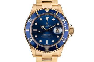 2002 Rolex 18K Submariner 16618 Blue Dial with Box and Papers photo