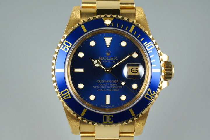 1985 Rolex YG Blue Submariner 16808 with Box and Papers photo