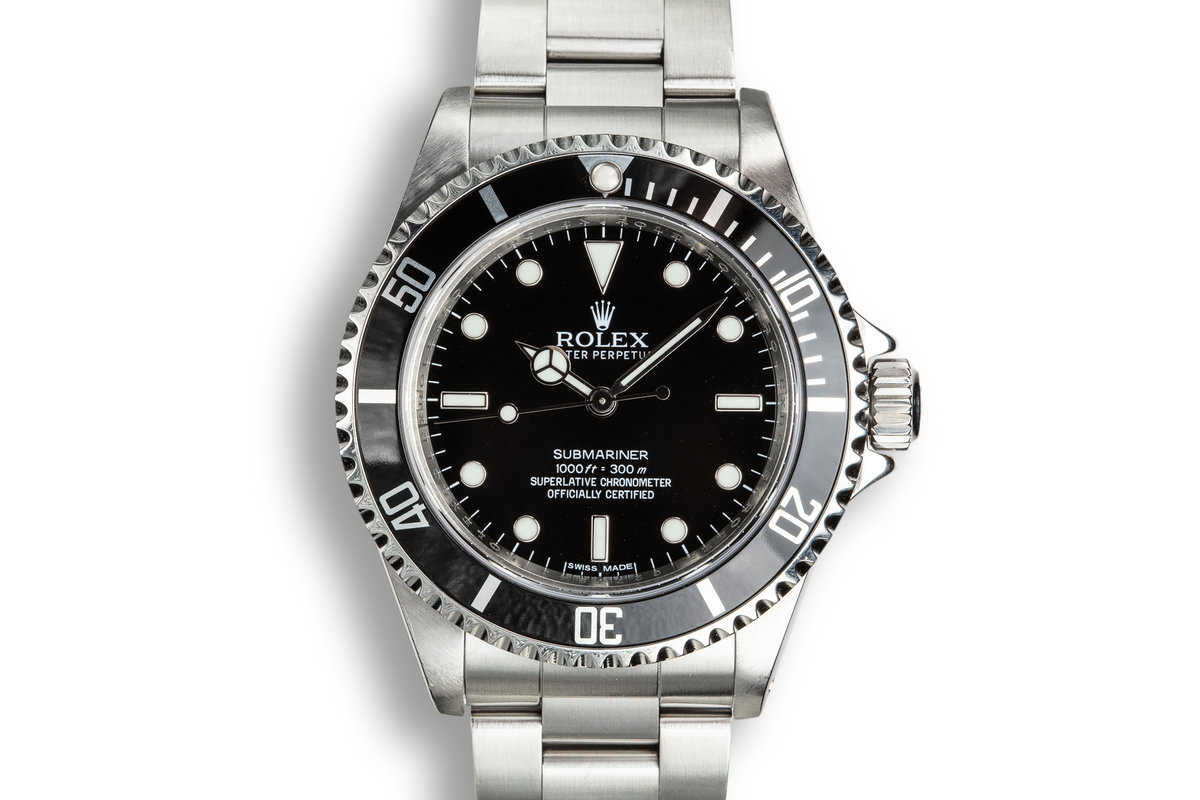2010 Rolex Submariner 14060 with 4-Line Dial and Box and Papers photo, #0