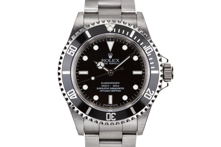 2010 Rolex Submariner 14060M Four Line Dial with Box and Papers photo