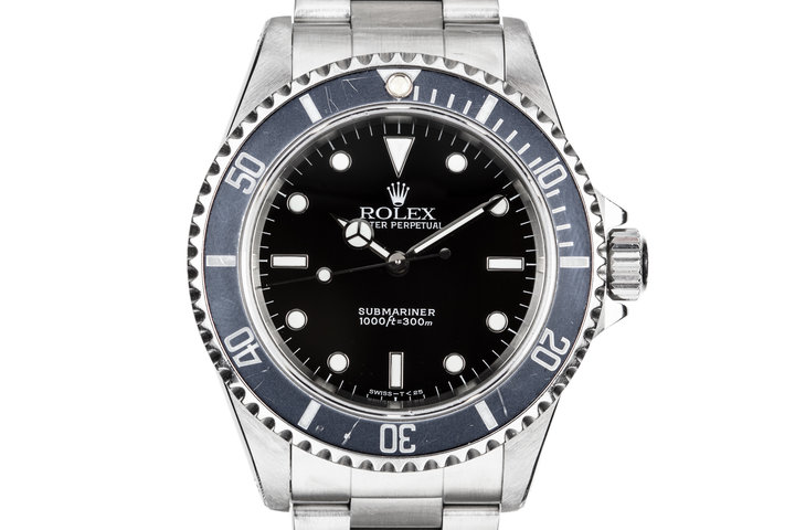 1995 Rolex Submariner 14060 with Faded bezel insert. photo