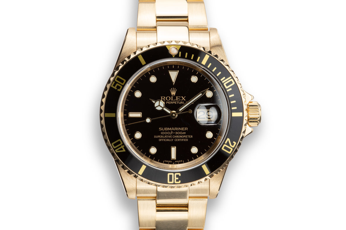 2003 Rolex 18K YG Submariner 16618 T Black Dial with Box, Papers, and Service Papers photo, #0