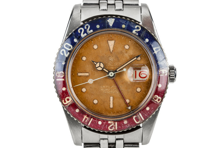 1957 Rolex GMT 6542 Gilt Tropical Dial with Bakelite Bezel photo