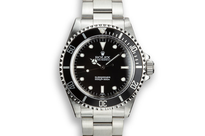 1999 Rolex Submariner 14060 with SWISS Only Dial with Box and Papers photo