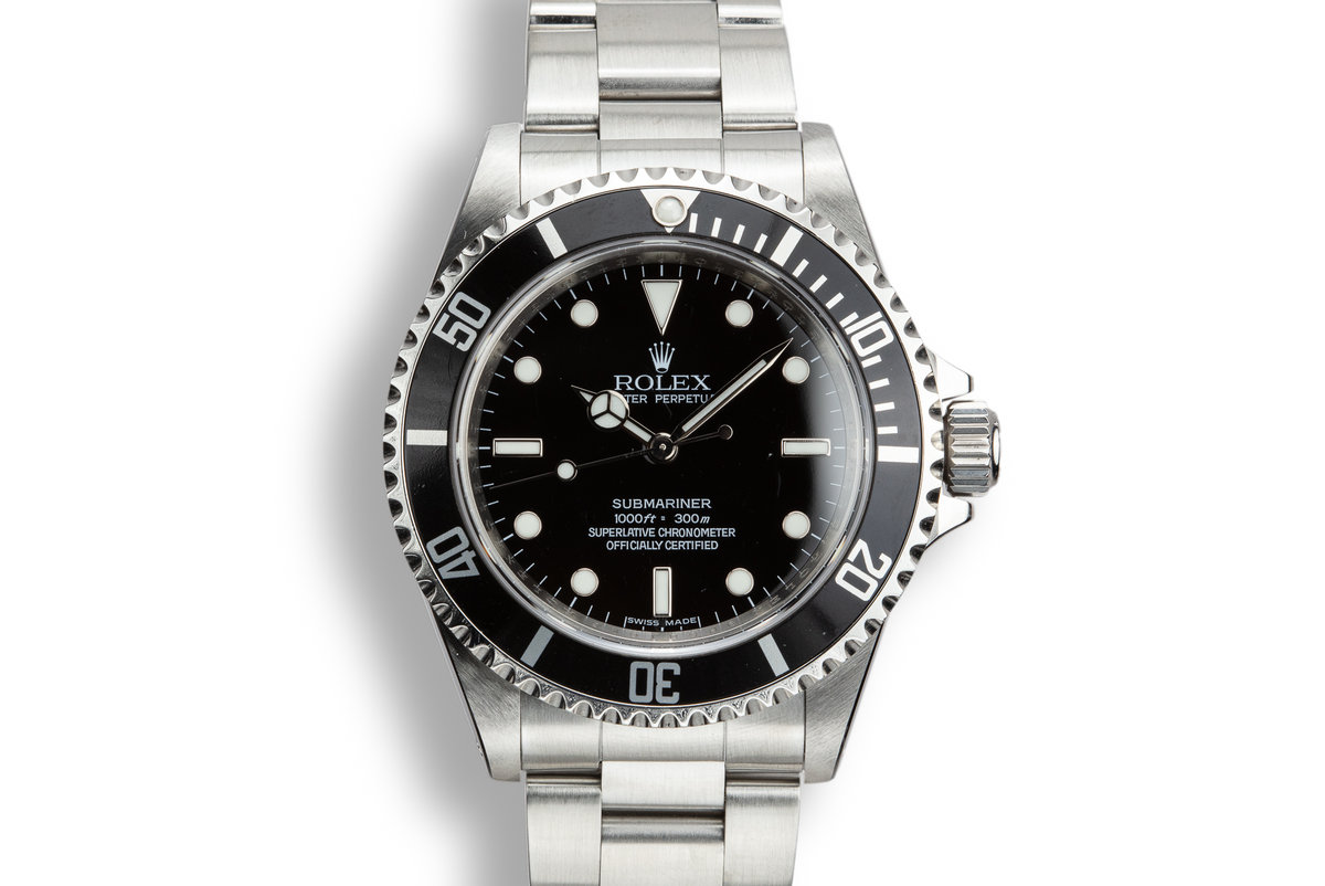 2012 Rolex Submariner 14060M with Four Line Dial photo, #0
