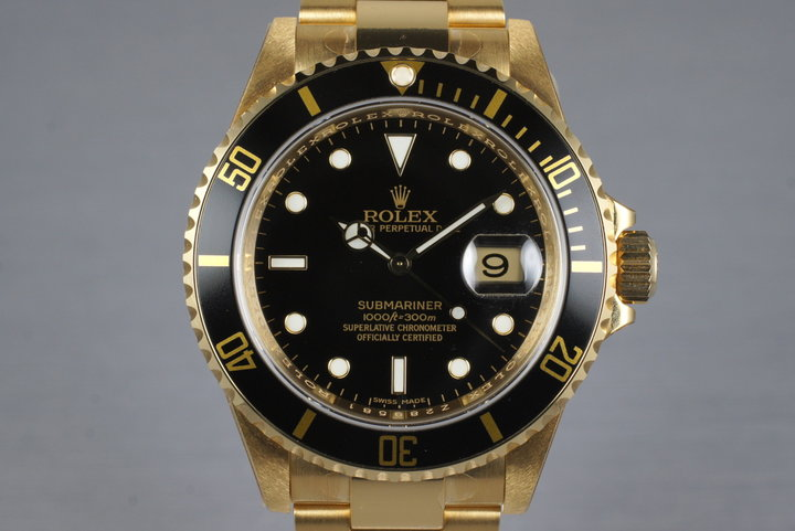 2006 Rolex YG Submariner 16618 with Box and Papers MINT with stickers photo