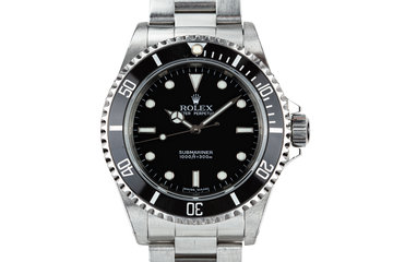 2004 Rolex Submariner 14060M with Box and Papers photo