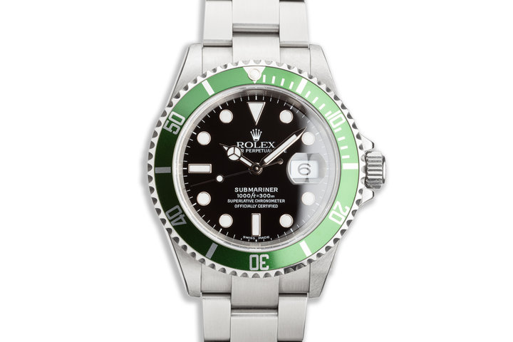 2005 Unworn Rolex Green Submariner 16610V with Box and Papers and Protective Stickers photo