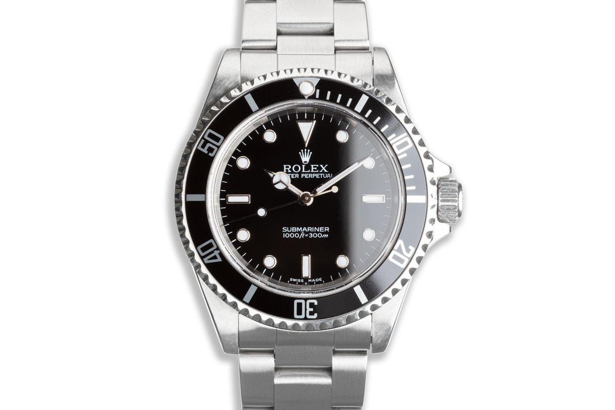 2001 Rolex Submariner 14060M with Box & Papers photo, #0
