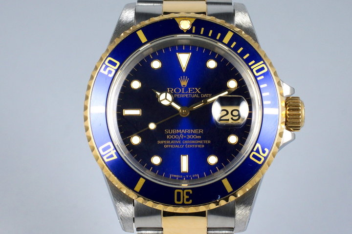 1995 Rolex Two Tone Blue Submariner 16613 with Box and Paper photo