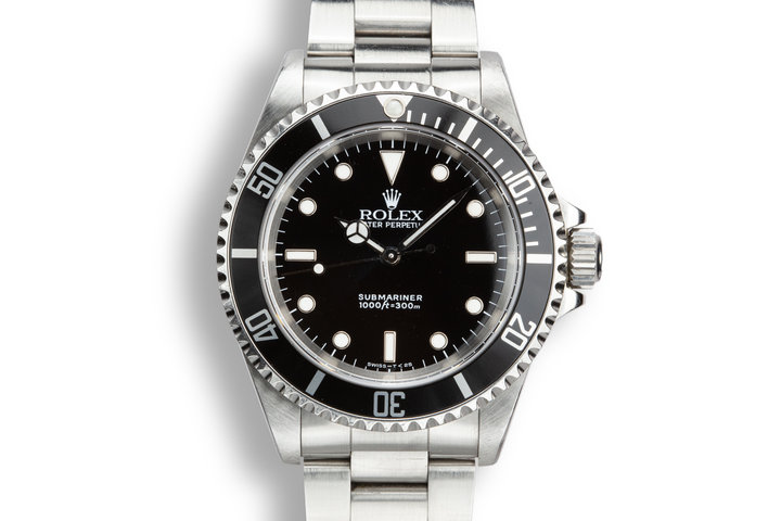 2002 Rolex Submariner 14060 with Service Papers photo